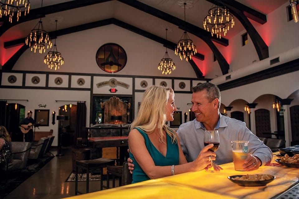Couple sitting at Gervasi Vineyard's The Still House bar